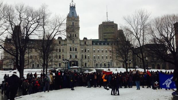 More than 200 people gathered outside the National Assembly Tuesday evening, hours after the Liberal government tabled its budget containing belt-tightening measures.