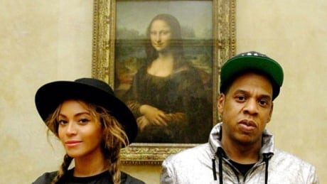 Beyonce and Jay Z in front of the Mona Lisa at the Louvre in Paris