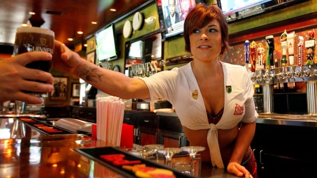 Establishments that require female servers to wear short skirts and low-cut tops may be liable for sexual discrimination if male servers are not required to wear similar attire.