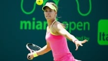 Milos Raonic advances, Eugenie Bouchard defeated in opening matches at Miami Open