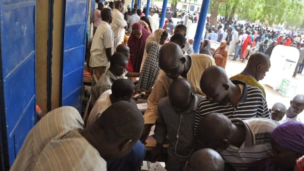 People in a camp for people that were displaced following attacks by Boko Haram, register to vote before casting their ballot in Maiduguri, Nigeria, Saturday March 28, 2015.