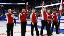 Earle Morris coaching son's rink at world curling championship