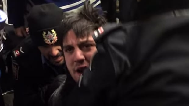 A screengrab from a YouTube video of the brawl at Union Station shows a TTC special constable, left, arresting a man, centre, after the two had exchanged blows on Jan. 29, 2015.