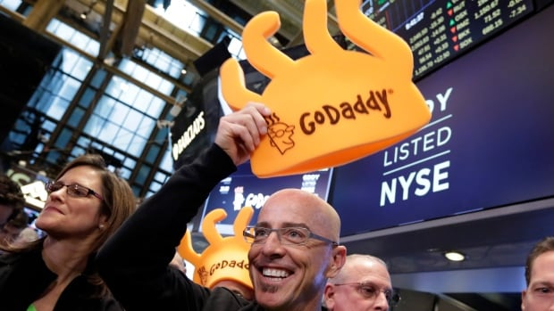 GoDaddy CEO Blake Irving holds a foam hat on the floor of the New York Stock Exchange as he waits for his company's IPO to begin trading on Wednesday.