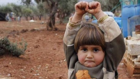 Syrian child hands up photo surrenders