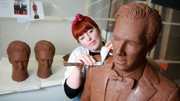 Chocolatier Jen Lindsay-Clark makes final adjustments to a life-size chocolate sculpture of actor Benedict Cumberbatch, which has been created to celebrate the launch of U.K. television channel Drama.