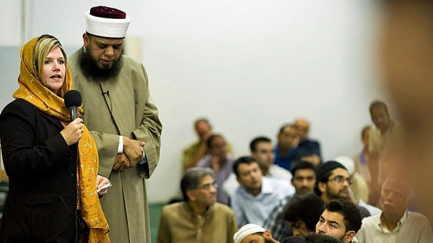 Ontario NDP leader Andrea Horwath speaks alongside Sheikh Faisal Razack at the Islamic Forum of Canada Mosque in Brampton during the 2011 provincial election. Politicians have come wooing, not always with great results.