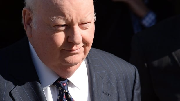 Suspended senator Mike Duffy leaves the first day of his fraud and bribery trial in Ottawa on Tuesday. Duffy pleaded not guilty to all 31 charges facing him.
