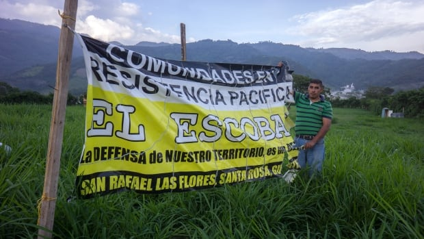 "A controversial mine owned by Vancouver-based Tahoe Resources faces opposition in Guatemala and a potential court case in Canada. Here, a banner reads ""Communities in Peaceful Resistance against Escobal."""