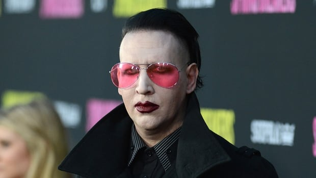 American shock rocker Marliyn Manson was shocked to get rocked by a 21-year-old man's fist while dining at a Denny's restaurant in Lethbridge, Alta., according to reports.