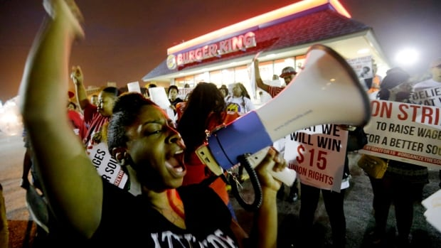 Carmen Burley-Rawls chants during a protest Wednesday outside a Burger King restaurant in College Park, Ga., by fast-food workers and activists calling for the federal minimum wage to be raised to $15.