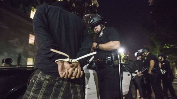 A demonstrator is arrested in Los Angeles during demonstrations against a decision by a Ferguson, Missouri grand jury to not indict a white police officer in the shooting of black teenager Michael Brown.