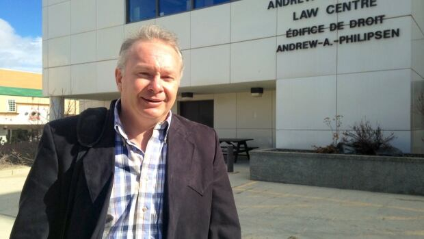 Ian Pumphrey of Whitehorse was ticketed in August 2014 for talking on his cellphone while driving. Yukon Supreme Court Justice Leigh Gower has convicted him on the charge, overturning an initial ruling that because it was wedged between his shoulder and his ear it met the definition of a hands-free electronic device.