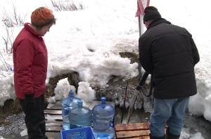 People collecting spring water