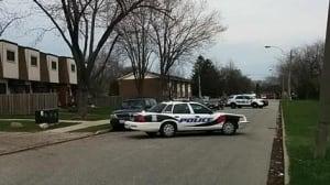 Police canvass the 5400 block of Lassaline Avenue.