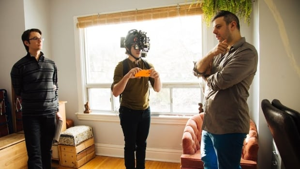 Filmmaker Elli Raynai, right, directs a scene in the virtual reality film I Am You. Raynai's filmmaking partner Alexander Konratskiy, left, was responsible for the majority of the programming that allowed for the film to be shot in VR.