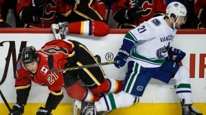 Flames down Canucks to clinch series victory