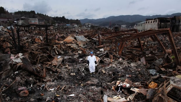 KESENNUMA, JAPAN - MARCH 21: Sigo Hatareyama works to clean out what is left of his house on March 21, 2011 in Kesennuma, Japan. (Photo by Chris McGrath/Getty Images)