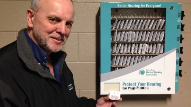 Leon Mills of CHHANL shows a set of earplugs from the new vending machine at Mile One Centre in St. John's.