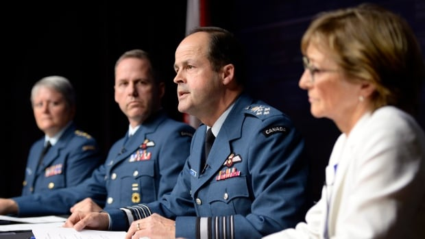 Gen. Tom Lawson, second from right, chief of the defence staff, speaks at a news conference in Ottawa April 30 following the release of a report on sexual misconduct in the Canadian Forces. Marie Deschamps, a former Supreme Court justice and the report's author is at right, and Maj.-Gen. Christine Whitecross, far left, is leading the military's response.