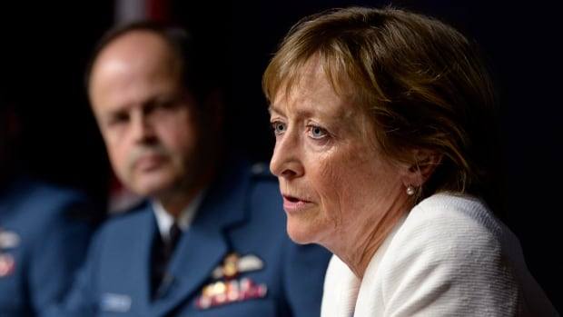 Marie Deschamps, a former Supreme Court justice and author of an inquiry into sexual misconduct in the Canadian Forces, speaks at a news conference in Ottawa on Thursday. Gen. Tom Lawson, who commissioned the report in response to media reports about the alleged abuse, is at left.