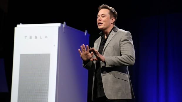 Tesla Motors CEO Elon Musk unveils large utility scale home batteries at the Tesla Design Studio in Hawthorne, Calif. on Thursday night.