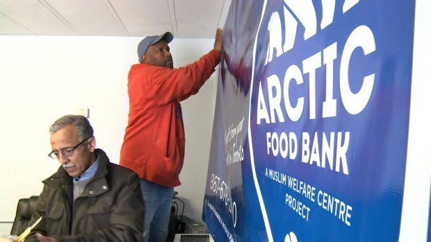 A sign is prepared for the new Arctic Food Bank, which opens today in Inuvik.