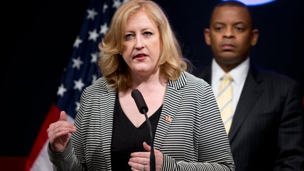 Transport Minister Lisa Raitt, with U.S. Transportation Secretary Anthony Foxx, announced new regulations for rail cars Friday in Washington.