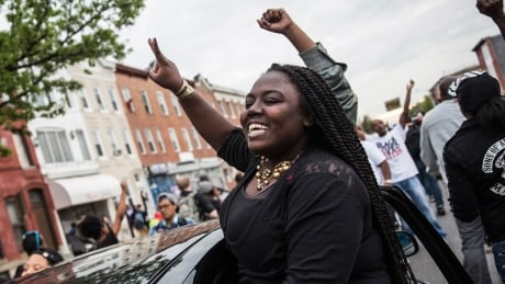 'No justice, no peace, no racist police': Freddie Gray marchers chant