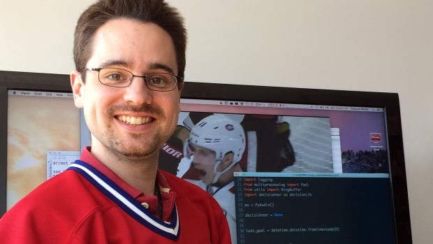 François Maillet poses in front of his TV monitor hooked up to his computer. When the Habs score, red, white and blue lights flash for about 30 seconds while playing the team's old goal song.