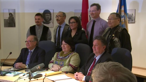 Nunavut leaders pose with Aboriginal Affairs Minister Bernard Valcourt, front left, in Iqaluit May 4. Next to Valcourt is NTI President Cathy Towtongie and Nunavut Premier Peter Taptuna. In back is Qikiqtani Inuit Association President PJ Akeeagok, Education Minister Paul Quassa, Nunavut MP Leona Aglukkaq, Finance Minister Keith Peterson and NTI vice-president James Eetoolook.