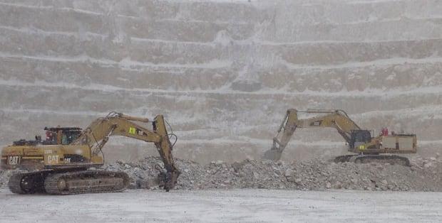 Digging rock at Victor Mine