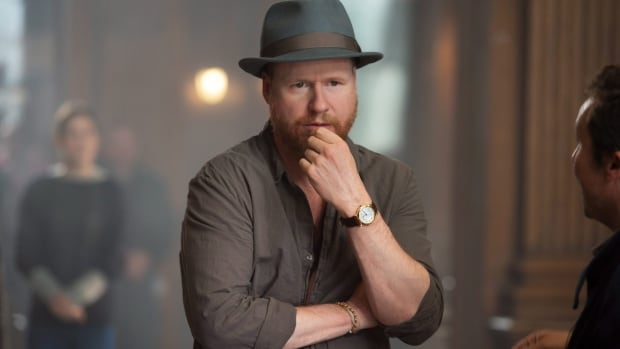 Director Joss Whedon, seen here on the set for Avengers: Age of Ultron, deleted his Twitter account on Monday after being deluged with angry and abusive messages over the film, especially its treatment of Scarlett Johansson's character Black Widow.