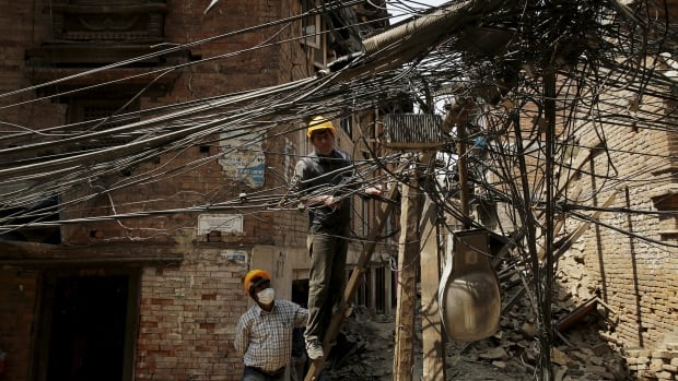 Engineers examine power lines brought down by the April 25 earthquake in Bhaktapur, Nepal on Wednesday.