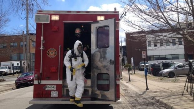 A hazardous materials team member prepares to enter the courthouse in Sydney, N.S., after a suspicious package was found Wednesday. Similar packages have been arriving at courthouses across Canada.