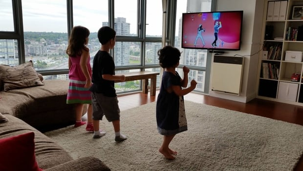 The living room in Adrian Crook's Yaletown condo has a thick rug for his kids to dance on.