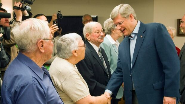 Prime Minister Stephen Harper, seen campaigning in 2011, introduced income splitting for pensioners in 2007. Now, his government is telling voters the opposition intends to end it. Not true, the NDP and Liberals say.