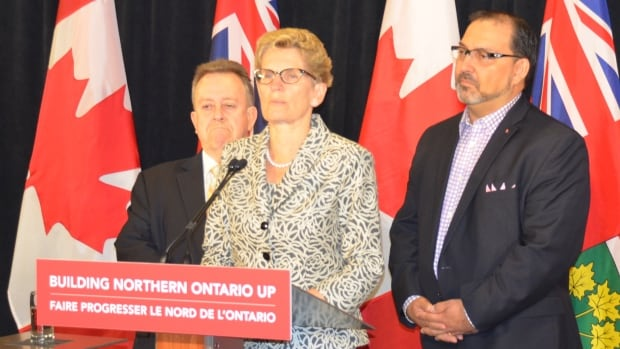 From left, MPP Michael Gravelle, Premier Kathleen Wynne and MPP Glenn Thibeault speak last May in Sudbury, Ont. Gravelle and Thibeault say they want to help northerners through Queen's Park in Toronto.