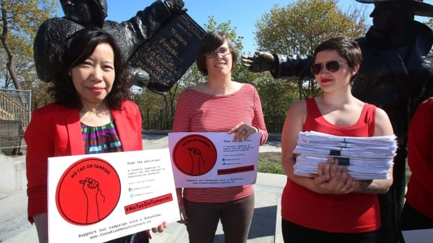 Lele Truong, Lareen Jervis and Mariana Hollmann, left to right, were on Parliament Hill earlier this month calling on the federal government to remove tax on feminine hygiene products. The government moved Thursday to lift the tax by July 1.