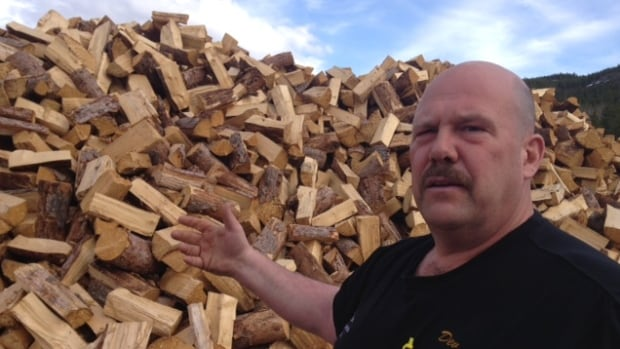 Dev Hurlburt processes and sells thousands of cords of beetle-killed firewood every year. 'It's definitely noticeable,' he says of the growing amount of rotting wood he has to pick out.