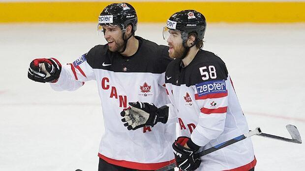Canada's Aaron Ekblad, left, celebrates a goal against Switzerland with teammate David Savard Sunday in Prague, Czech Republic.