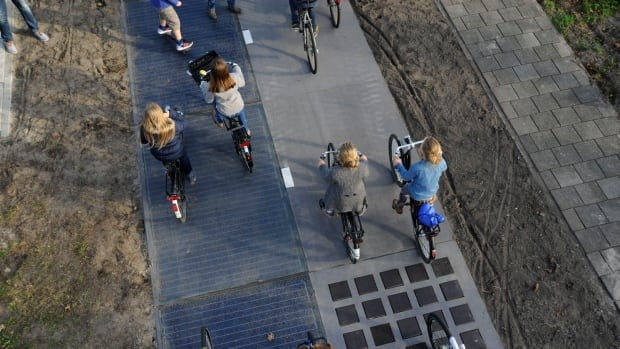 A solar bike path has generated more than 3,000 kilowatt hours since the 70-metre-long strip, on the left, officially opened in November 2014.