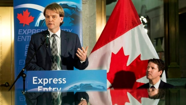 "Immigration Minister Chris Alexander, shown here giving an update on the express entry last month in Toronto, has said the new immigration system was getting  ""impressive results"" in its first month."