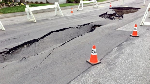 A sinkhole that appear on Albert Street in Burnaby, B.C. on Monday appears to have expanded overnight.