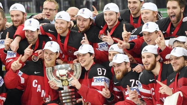 Team Canada celebrates with the trophy after winning the gold medal match against Russia at the 2015 IIHF Ice Hockey World Championships on Sunday at the O2 Arena in Prague.
