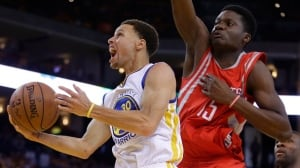 Warriors hold off Rockets rally to win Game 2