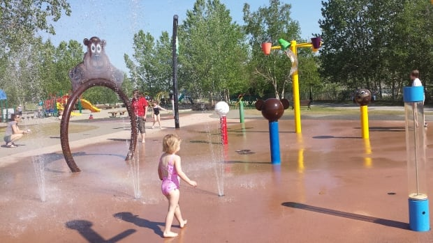 Families are getting a break from the heat in water play area in Rotary Peace Park, Whitehorse.