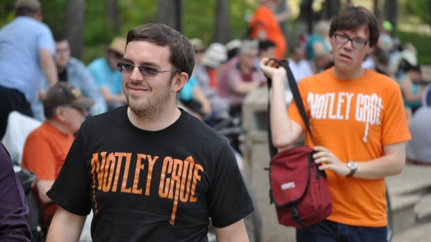 NDP supporters wear Notley Crue T-shirts at the swearing-in ceremony for Rachel Notley's government.