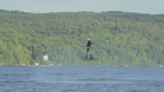 Alexandru Duru uses his hoverboard machine to travel more than 250 metres — five times the previous record — at a height of five metres above Quebec's Lake Ouareau.