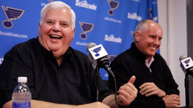 Blues head coach Ken Hitchcock, left, and general manager Doug Armstrong, right, share a laugh during Tuesday's news conference announcing Hitchcock had signed his third one-year deal with the team. They weren't smiling a few weeks ago when St. Louis was ousted from the playoffs in the first round for a third straight year.